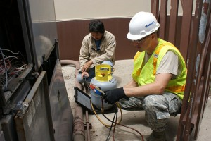 HVAC Furnace Technicians performing furnace maintenance