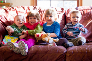 Photo of family sitting on home couch.