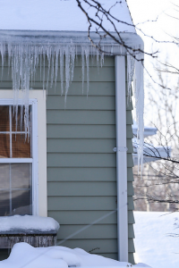 Icicles hang off of roof during cold winter weather.