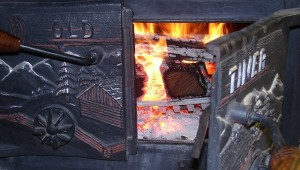 Photo of an old woodstove with a fire inside.