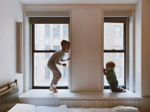 kids-playing-by-window