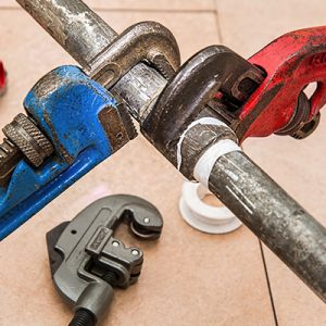 Wrenches-used-to-repair-pipe